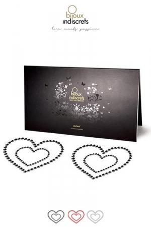 Bijoux de Peau Mimi Coeur : Combinez romantisme et séduction avec les décorations corporelles Mimi Cœur qui subliment toutes les poitrines.